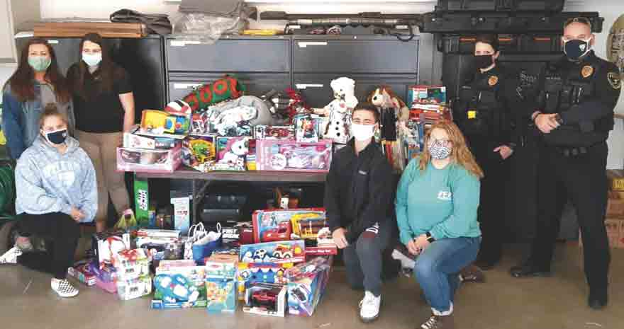 Upper Iowa University Peacocks for Progress members presented the Fayette Police Department with approximately $1,000 worth of UIU community donations to the Christmas Toy Drive on Wednesday, Nov. 18. All funds/toys will go to Helping Services for Youth and Families, and the Riverview Center....