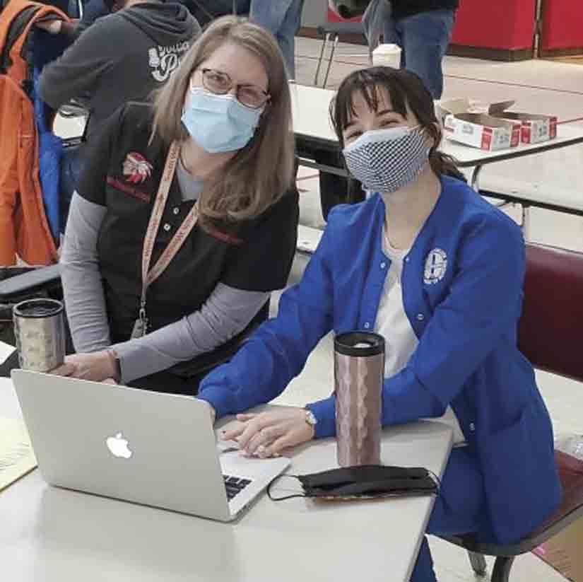 A total of 106 teachers, administration, and staff at South Winneshiek received COVID-19 vaccinations last week through Winneshiek County Public Health. School nurse, Brandi Hemesath, MSN, RN (left), and Luther College nursing student Tracy Lansing work to keep the process running smooth and keep...