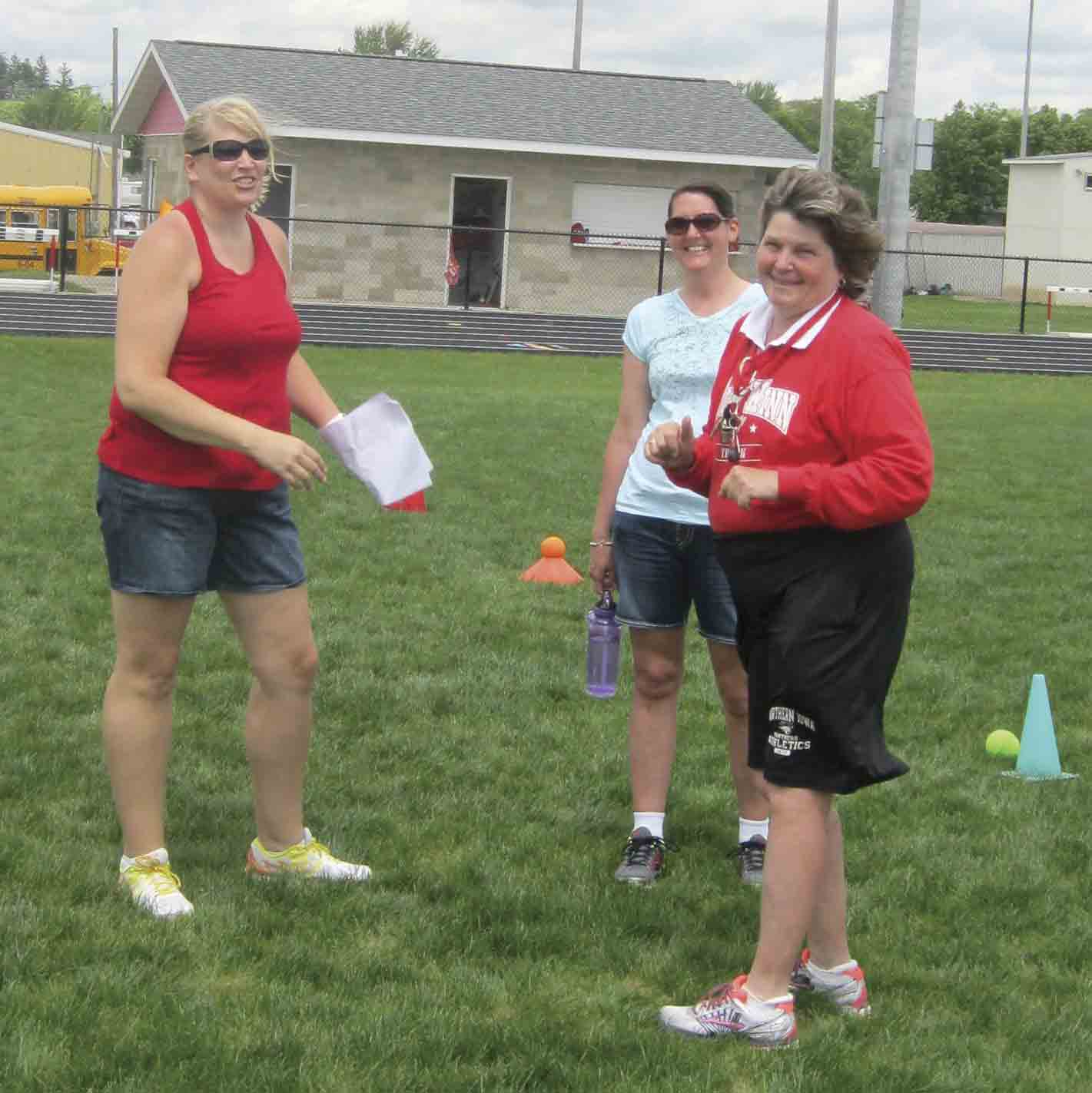 Sue Cook (right) helps organize a track and field event alongside Sherry Poshusta (left)and Mary Kleve at the South Winneshiek Athletic Complex in Calmar. Cook, who has taught at South Winneshiek since 2005, has been a teacher at several Iowa school districts for 39 total years. (submitted...