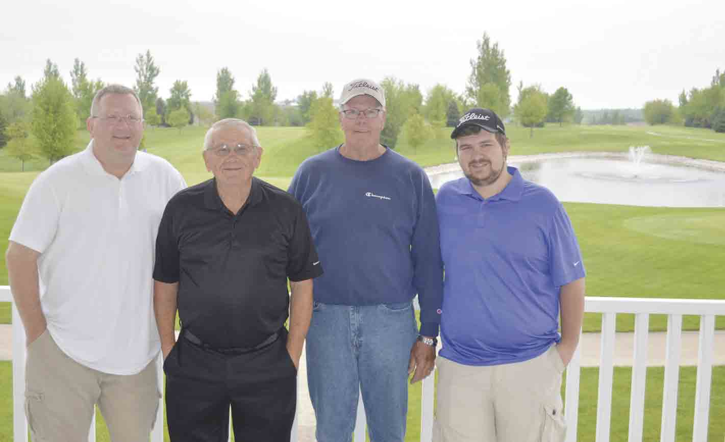 Jim Mathis, course manager; Arlan Paulson, board member; Roger Koenig, board president; and Nathan Winter, employee (l-r) stand on the porch of Silver Springs Golf and Country Club in Ossian. The local golf course will celebrate its 25th anniversary this summer and will celebrate by hosting a...