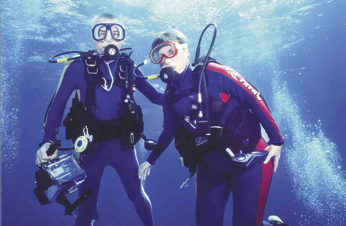 Ron and Judy Duckett from 2003 diving in Tahiti. As you can see, Ron has camera in hand. (Submitted photo)Dive, Dive, DiveBy Jack Swansonjswanson@fayettecountynewspapers.comIf you wanted to call Ron and Judy Duckett the Cousteau's of Iowa, there would...