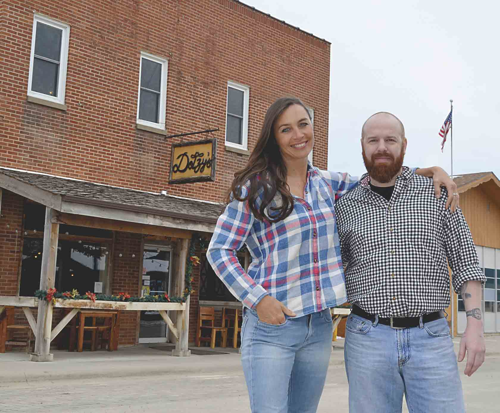 Danielle Dotzenrod (left) opened Dotzy's on March 12, 2013. On Dotzy's fifth birthday last Monday, she handed over the local restaurant to new owner Michael Ellison, who has been working as a chef at the restaurant. Chris DeBack photos 	Dotzy's torch...