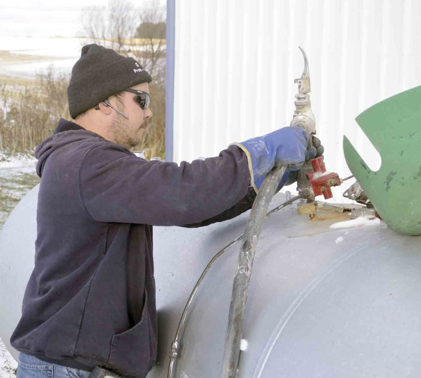 Shawn Alber, a certified propane specialist with AgVantage FS, fills a liquid propane tank on Monday afternoon in Fayette County. Much of the Midwest is experiencing difficulties with trying to keep farmers stocked with LP as a mixture of factors have contributed to a heavy-use fall that has...