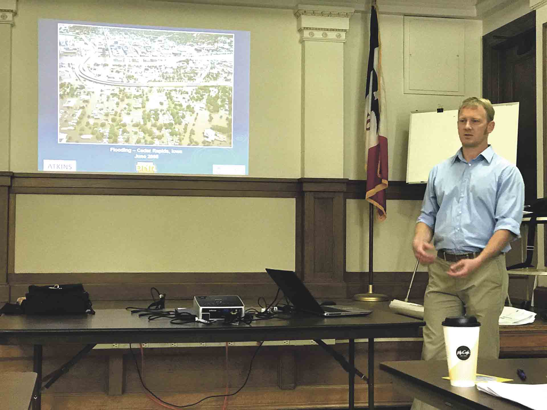 Ken Bouma, DNR NFIP specialist, presents the new preliminary flood insurance rate maps (FIRMs) to officials from different municipalities in Fayette County on Thursday, June 14. A meeting was held for the general public later that evening. Chris DeBack photo 	New preliminary...