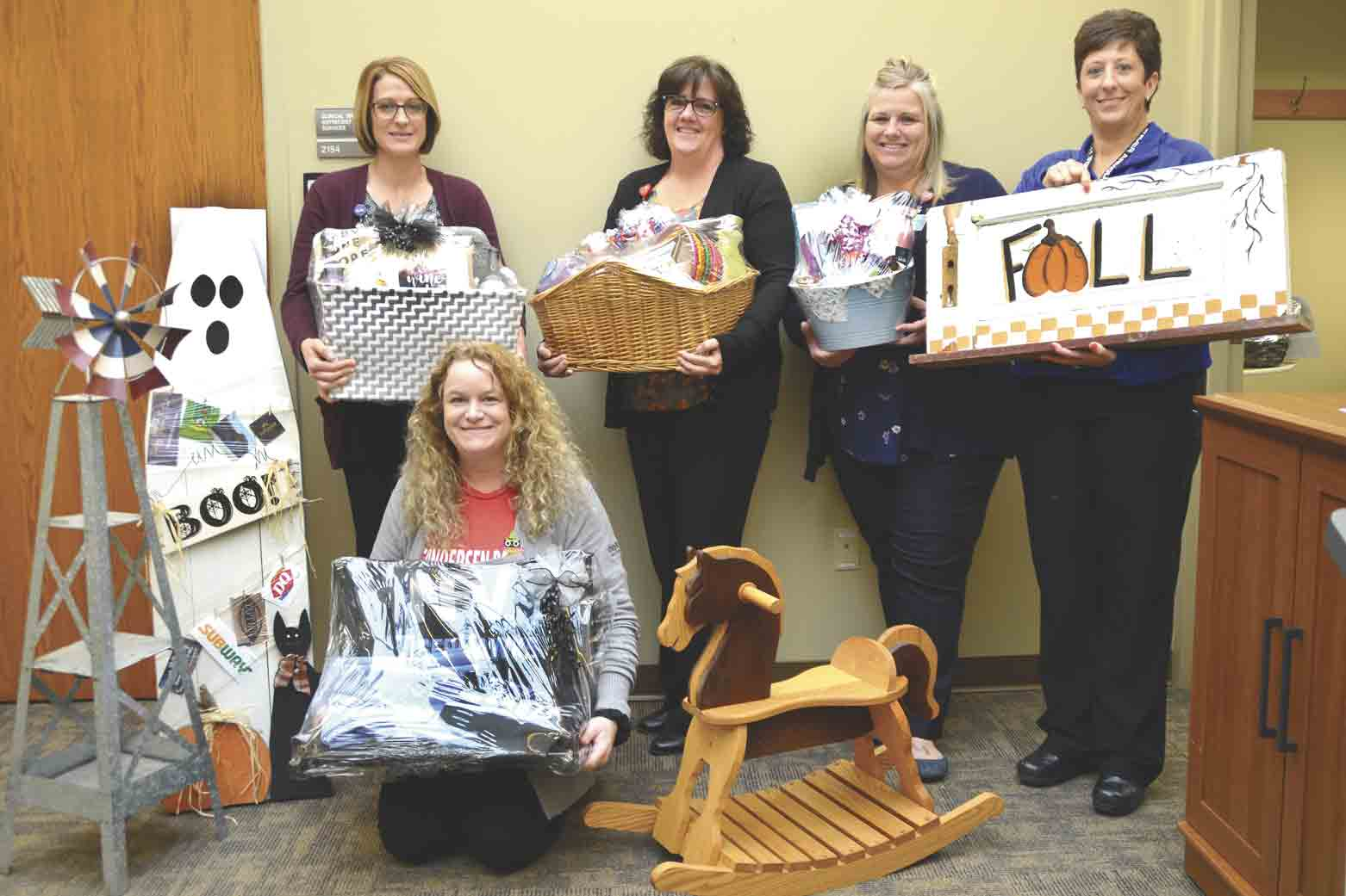 There will be baskets filled with almost anything imaginable along with other gifts available for silent auction at the Palmer Memorial Foundation Fall Fund Fest, Thursday, at Gundersen Palmer Lutheran Hospital and Clinics in West Union. Pictured are hospital staff with some of the baskets and...