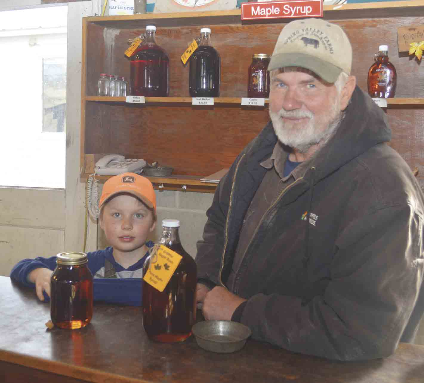 Inside the evaporator house, Dale Green and grandson John Melcher work on another batch of Sugarbush maple syrup, a nearly 170-year-old family tradition that was brought to rural Castalia by Dale's great-great-grandfather in 1851. John is the seventh generation of the family to...