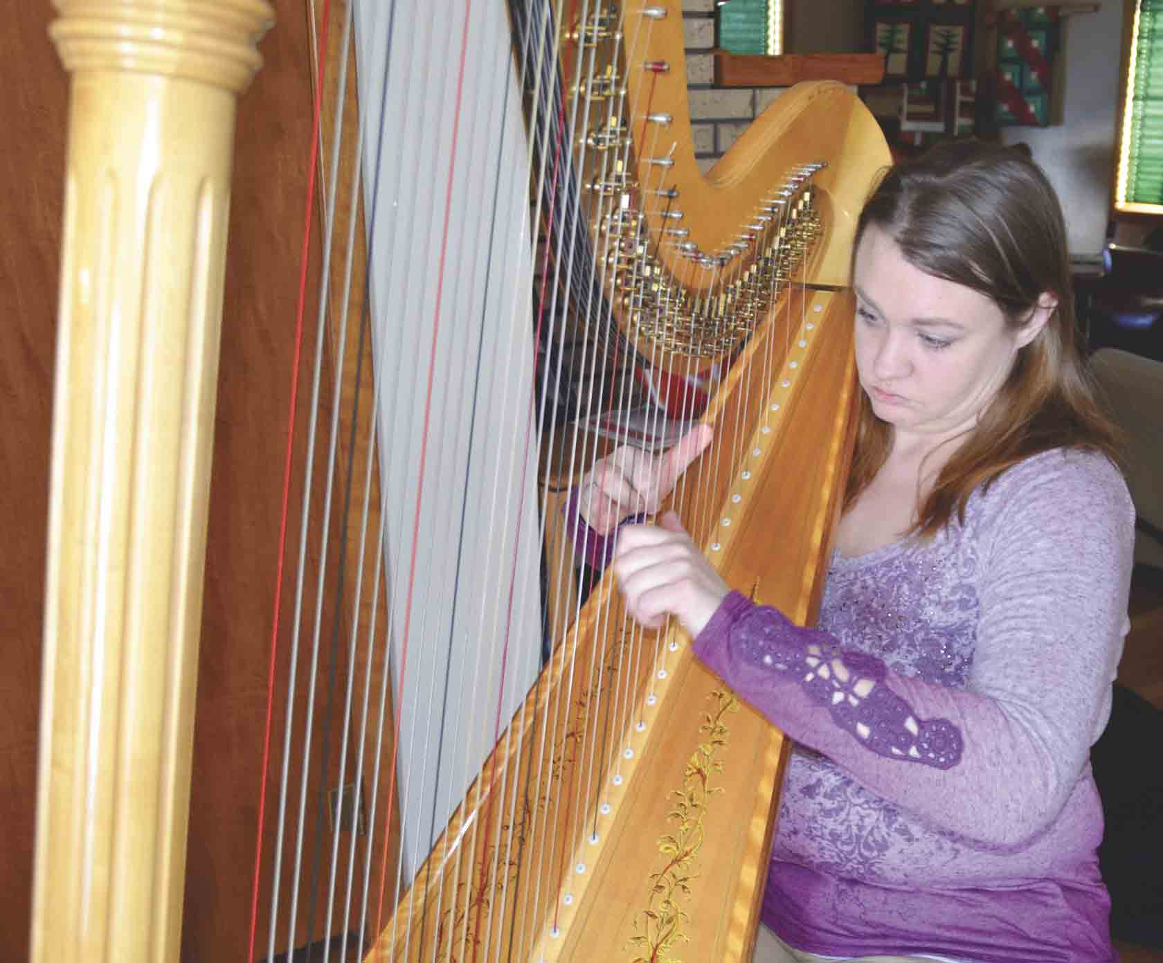 With several methods for learning the harp, Leisl Schutte learned the Suzuki Method, which is based on memorization and listening. (Chris DeBack photos) 	 	 	Local harpist inspired by grandmother's painting  By Chris Deback	cdeback@...