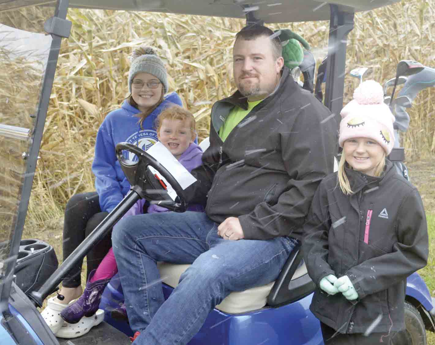 Mitch Holthaus and his family, including daughters (l-r) Alyssa, Ella, and Jadyn, plans to take advantage of the new Ossian ordinance that will allow golf carts and UTVs on City streets next year. (Zakary Kriener photo)Golf carts, UTVs soon to be allowed in OssianZakary KrienerNews...