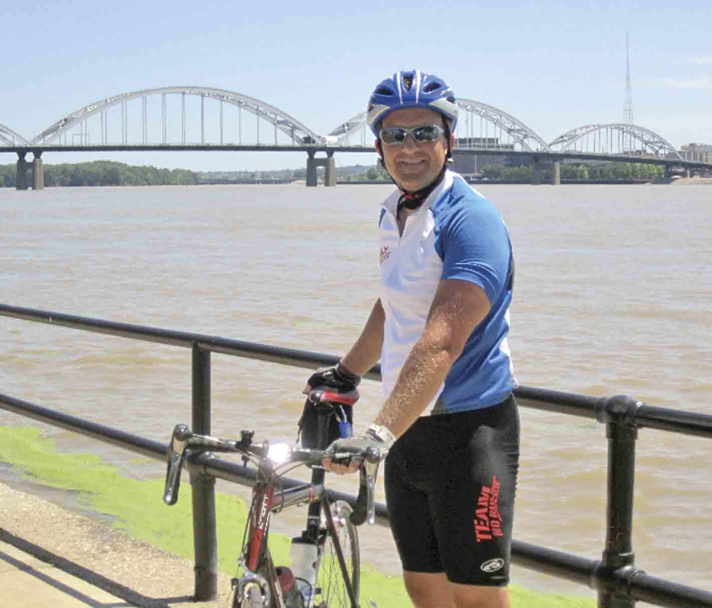 Jason Halverson stands in front of the Mississippi River in Davenport after completing a past RAGBRAI ride. Next week, the South Winneshiek Elementary/Middle School principal will make his way across the state of Iowa for the 10th time on a route that includes stops in both his...