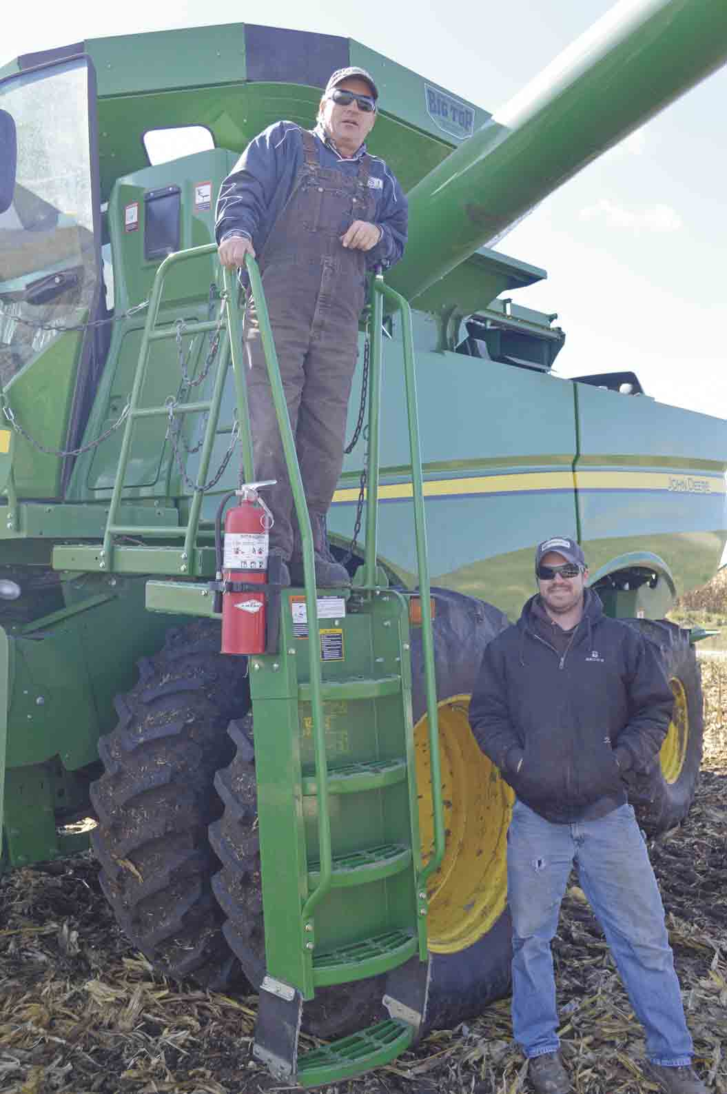 Like other area farmers, father Ernie (top) and son Jeremy Soppe of rural Hawkeye are hard at work in the fields this week. Despite being in the middle of one of the toughest and rainiest harvest seasons in their memories, the two are optimistic about the upcoming forecast. (Zakary Kriener...