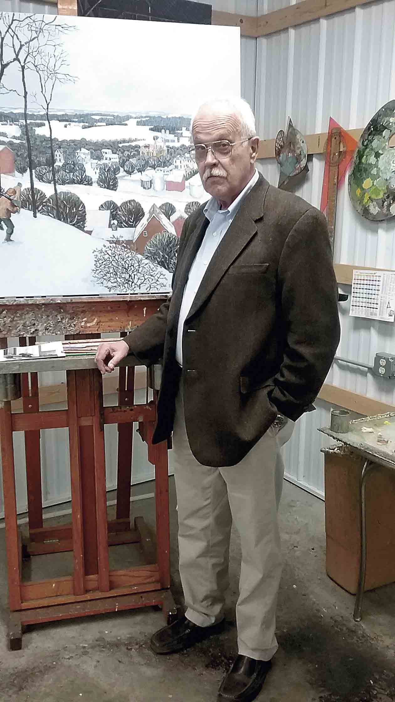"Painter Jim Updegraff of West Union will be displaying his artwork on the Northeast Iowa Artists' Studio Tour on Oct. 12-14. Behind him, his snowy landscape painting was inspired by the view of Eldorado and from the painting ""Hunters in the Snow"" by Pieter Bruegel the..."
