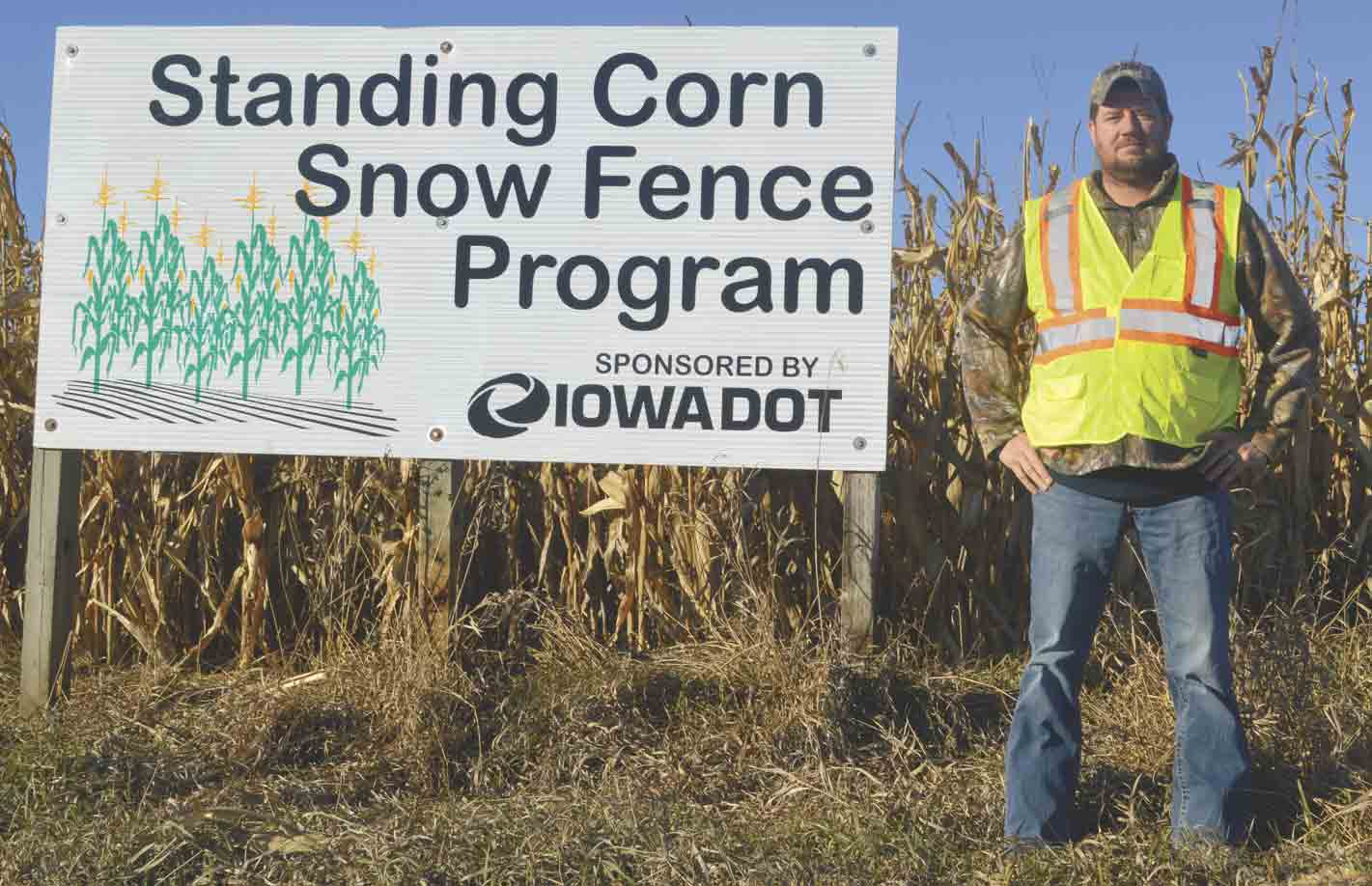 oel Monroe, Iowa Department of Transportation highway maintenance supervisor, points out one of the local standing-corn snow fences utilized throughout northeast Iowa to minimize blowing and drifting snow on adjacent roadways. (Zakary Kriener photo)Iowa DOT promoting standing-...