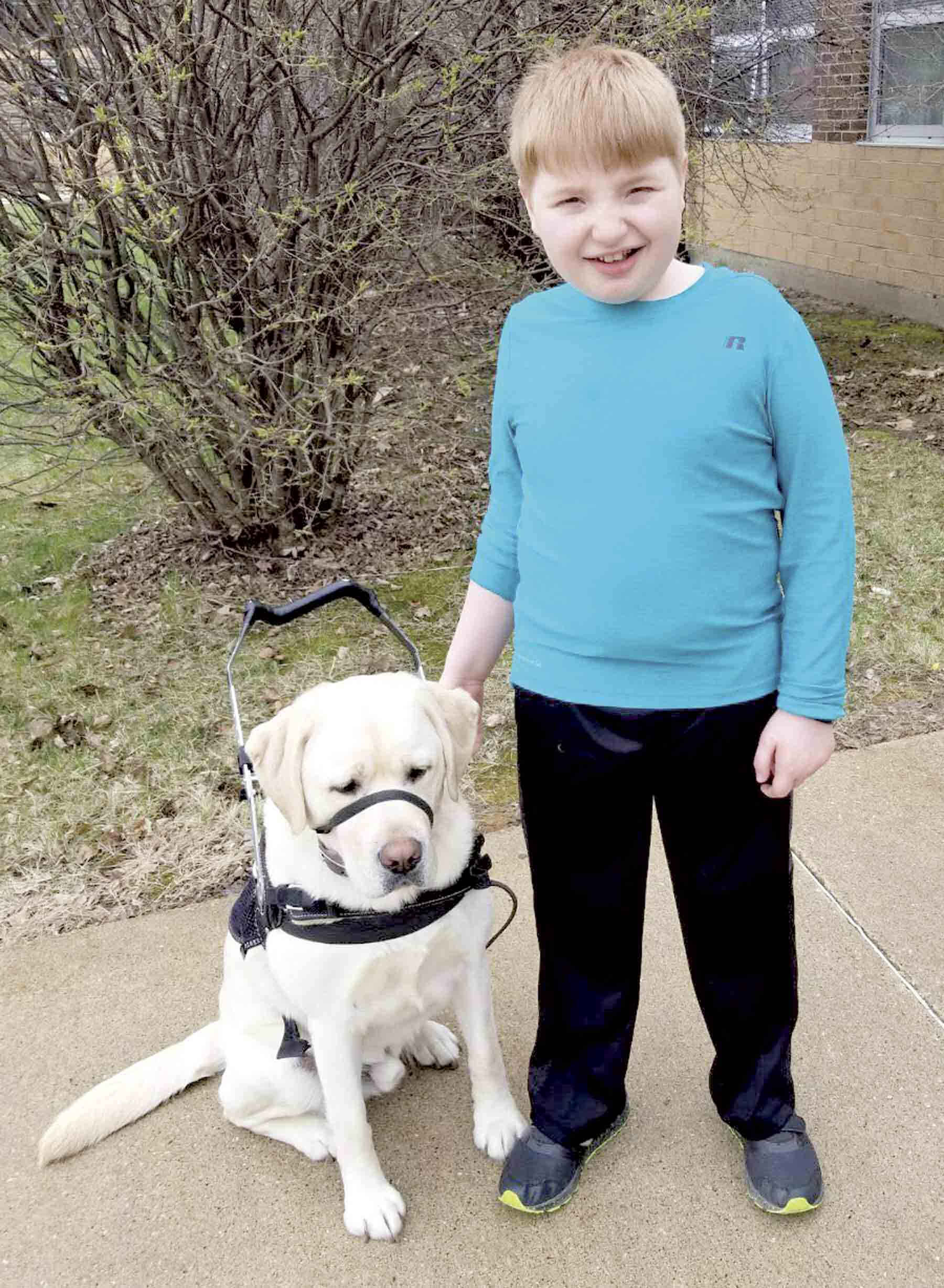 Liam, pictured here with his support dog, Sarge, will be well represented at the third annual 3rd Annual Iowa Strollathon, a fundraiser for Rett Syndrome research at Kinzler Construction in Ankeny on Saturday May 4th from 11a.m. to 2 p.mWoods takes a stroll towards a cure...