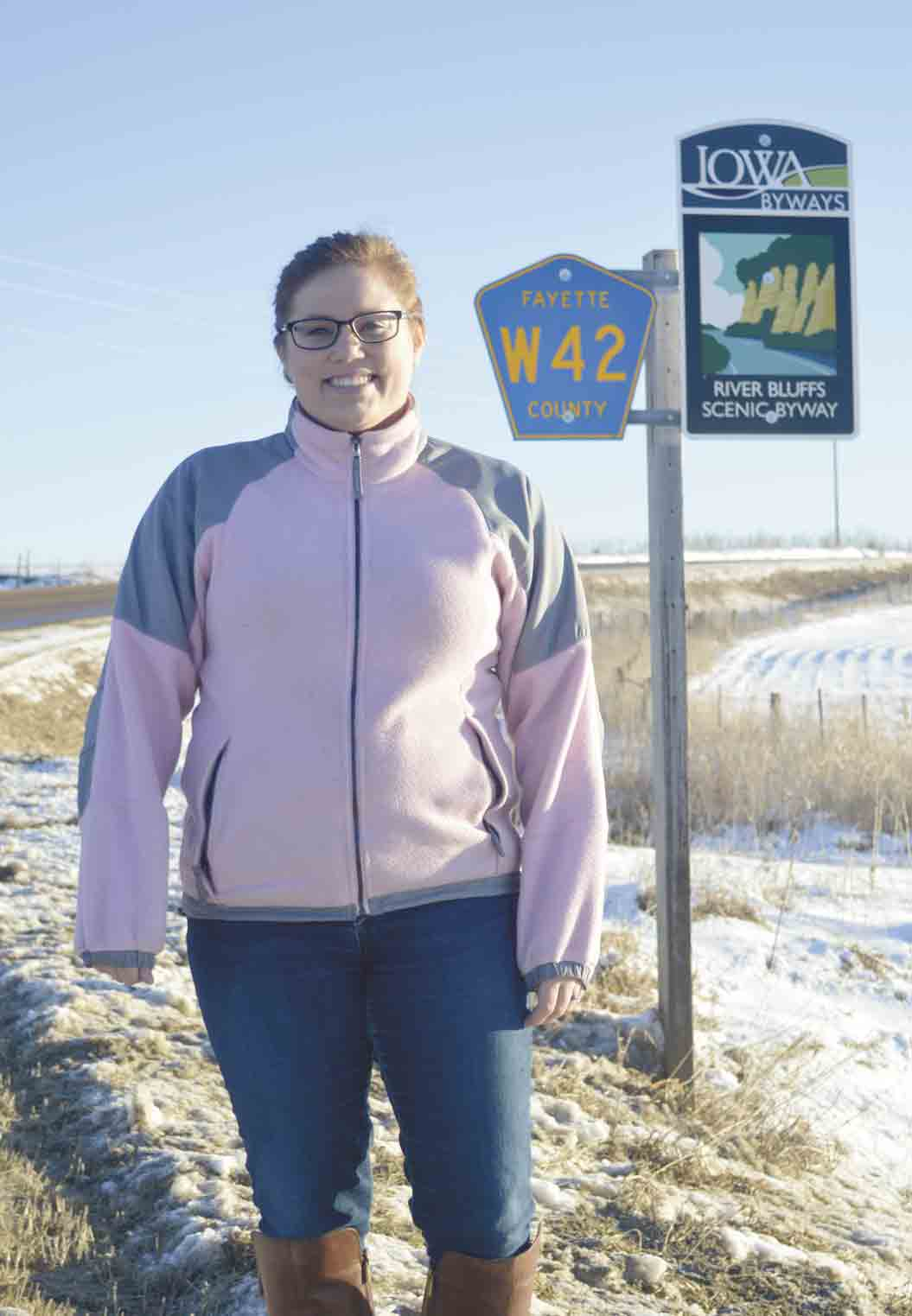Mallory Hanson, a regional Iowa Byways coordinator and regional tourism and economic development coordinator for Northeast Iowa Resource Conservation and Development (RC&D), stands near one of the many Iowa Byways signs throughout northeast Iowa. Her region oversees four of Iowa's...