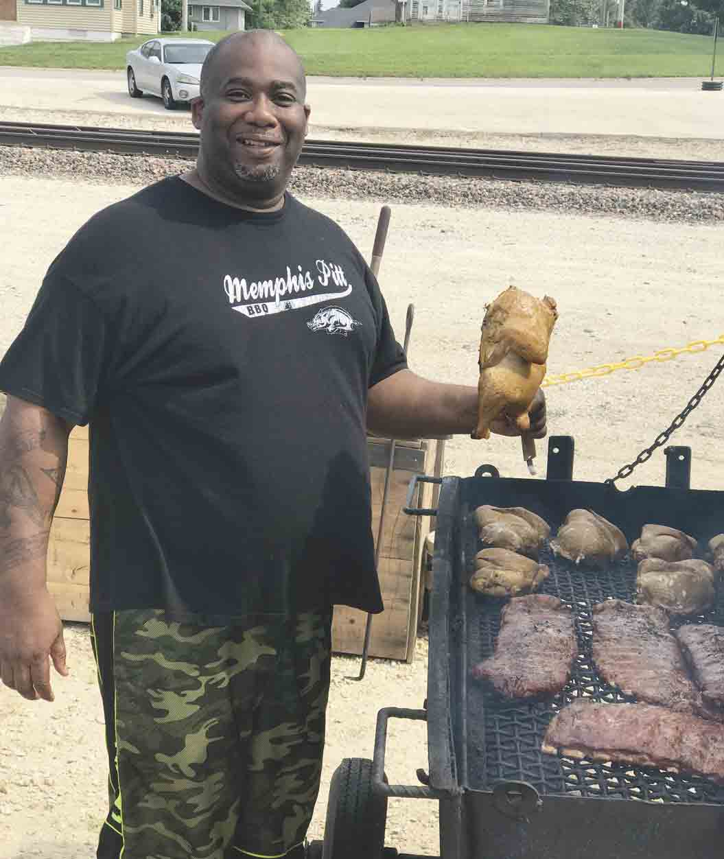 Memphis Williams, owner of the new Memphis Rae BBQ, smokes some brisket and chicken for the night's guests as the new Calmar restaurant is now officially open. Memphis Rae BBQ, located at 115 E. Main Street, features a full BBQ menu that will eventually expand to offer a Southern-...