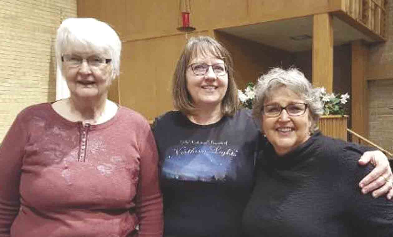 These three ladies from Clermont have performed in the Northeran Lights Women's Chorale group for many years.  Pictured, L-R, June Swenson, Deb Matt and Peggy Kittelson. (Vicki Rowland photo) 	Local women shine in Northern Lights   Vicki Rowland...