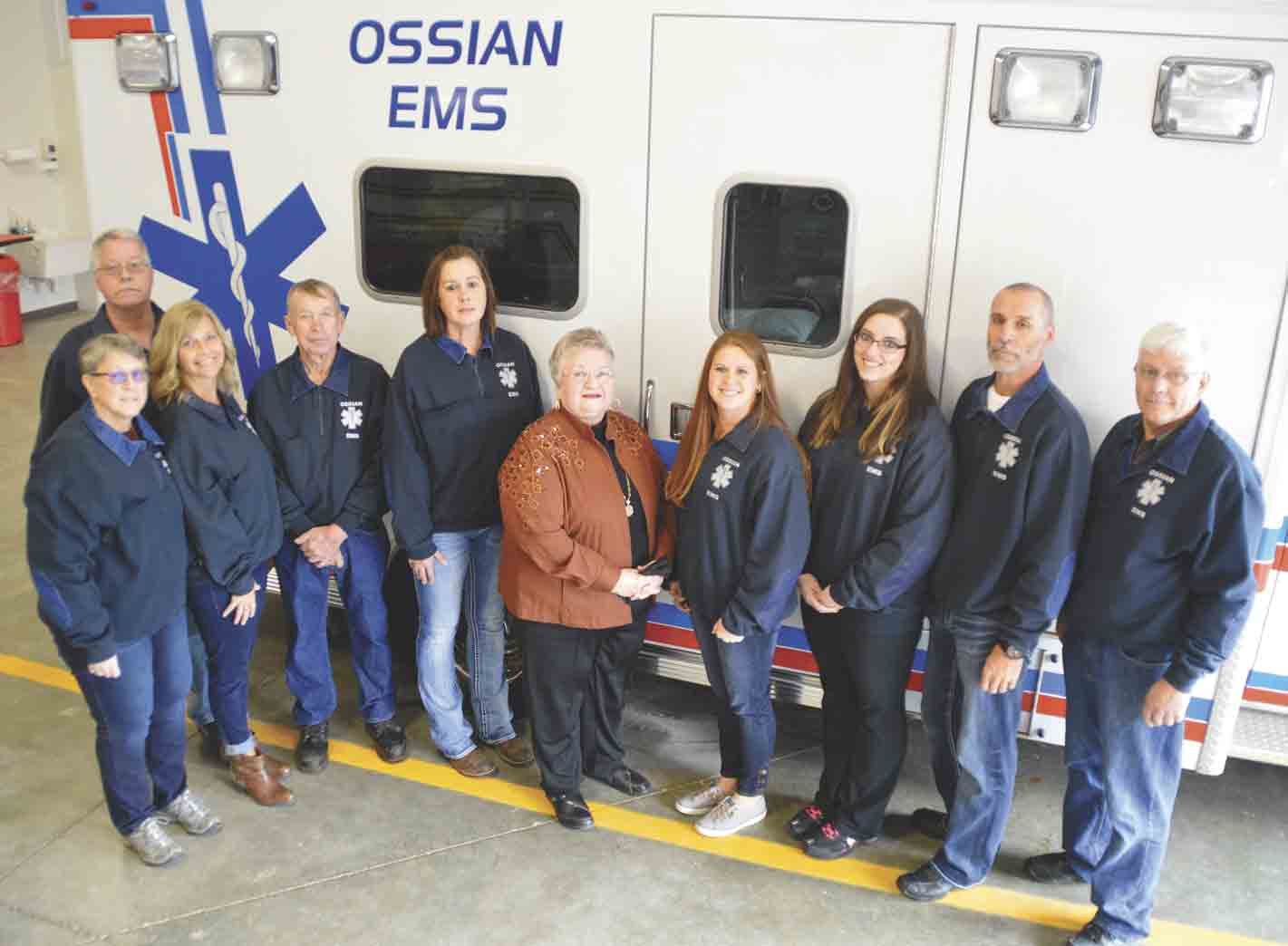 Members of the Ossian volunteer EMS crew include (l-r) Bonnie Steinberg, Denis Holien (back), Lynette Wenthold, Darwin Linderbaum, Lori Hemesath, Eleanor Drew (treasurer), Jackie Becker, Ana Scott, Terri Wenthold, and Dale Beckman. Missing from the photo is Leland Monroe. (Zakary Kriener...