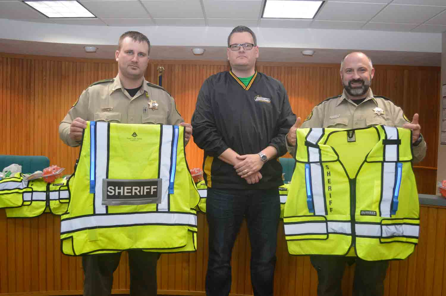 Winneshiek County Lieutenant Steve Nesvik (left) and Chief Deputy Jeff Berns (right) display the newly acquired safety vests, purchased through grant money by Sean Snyder (center), Winneshiek County Emergency Management coordinator. The vests, as well as new battery-powered road flares,...