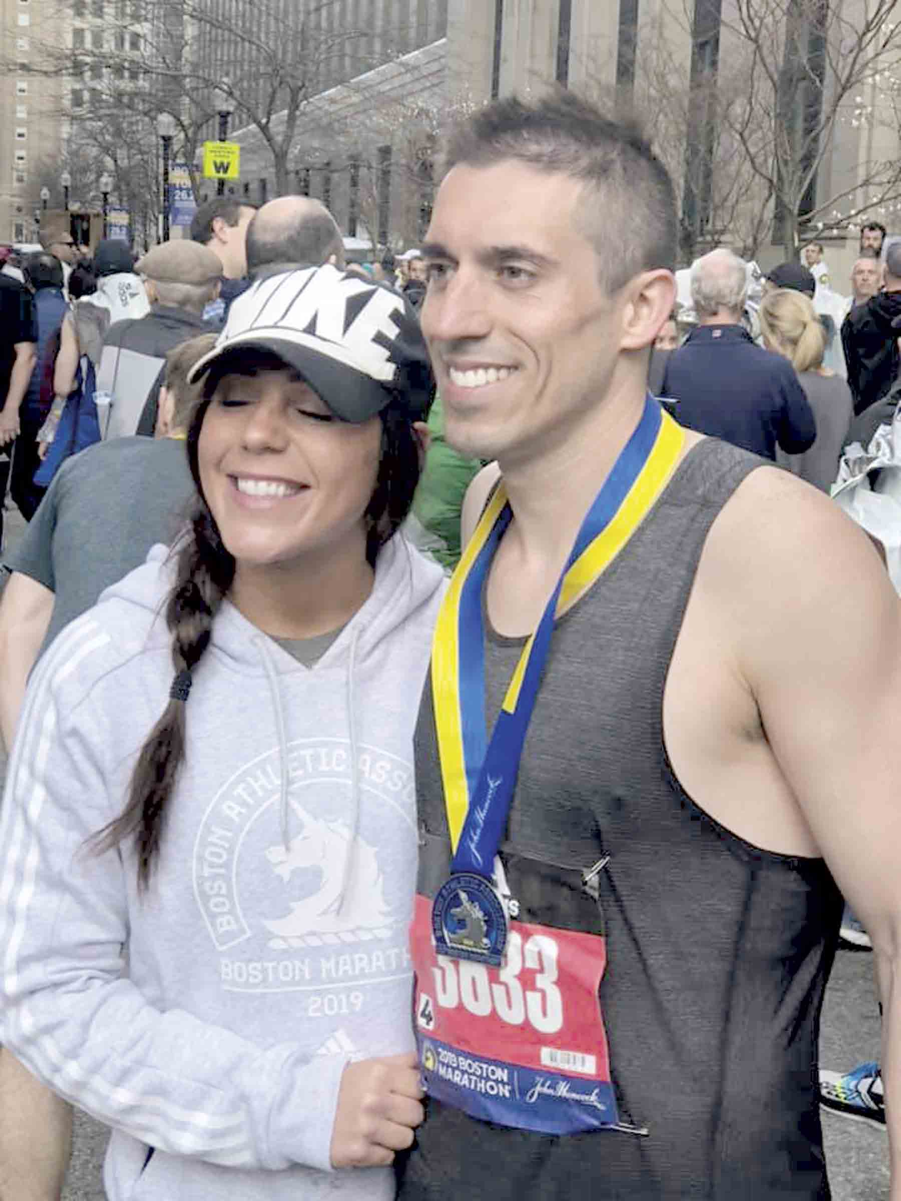 Zach Schmit, a 2002 North Fayette graduate, gets a big hug from girlfriend, Chelsi Baker after his run in the Boston Marathon Monday morning. Since adding it to his bucket list five years ago, Schmit has trained tirelessly to participate in the prestigious race. (submitted photo...