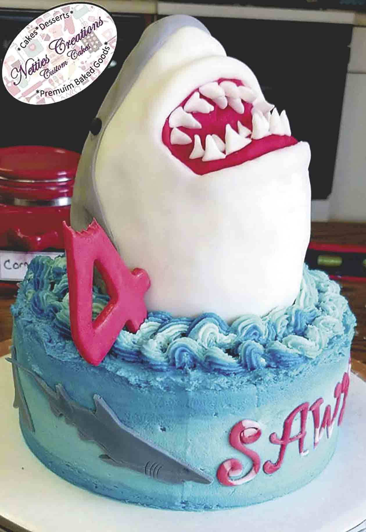 Taking a big bite out of turning 4 years old, this shark-themed birthday cake was baked and decorated by Lynnette Henry of West Union. Under the fondant icing, the shark head is made out of Rice Krispies. (Photo submitted)For Henry, it's icing on the cakeBy Haley...