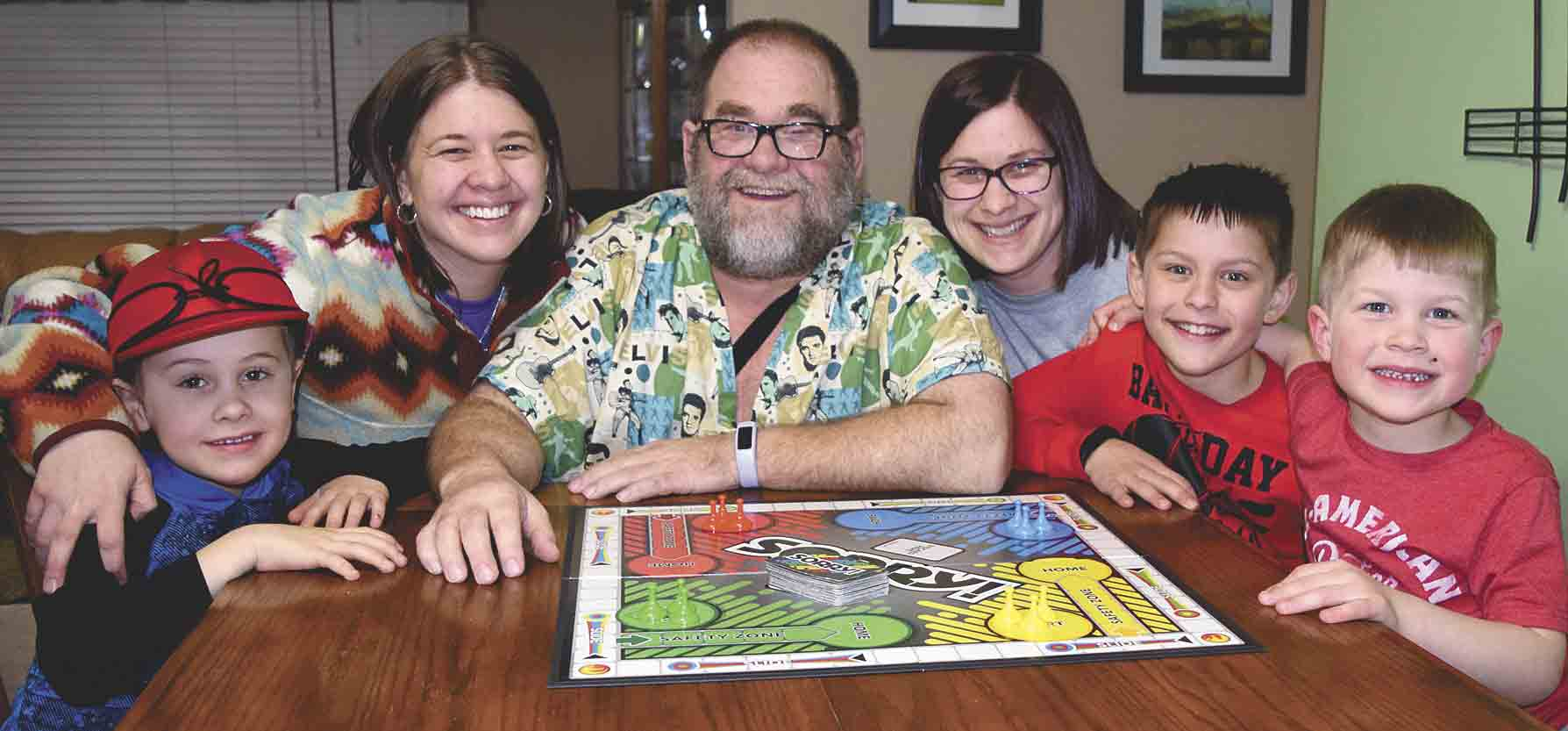 Surrounded by his family, Steve Friederich (center) celebrates his 62nd birthday on Saturday, Feb. 10, shortly after having single-bypass surgery at Gundersen Health System in LaCrosse, Wis. Enjoying a board game on his birthday were (l-r) grandson Clayton Loftsgard, daughter Steph...