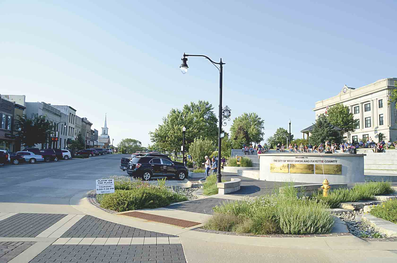Wednesday, July 11, was the five-year anniversary of the grand opening of the West Union Downtown Streetscape Project. The following evening, the Civic Plaza at the corner of Vine and Elm streets was filled with local residents enjoying the beauty of the streetscape during the Playin...