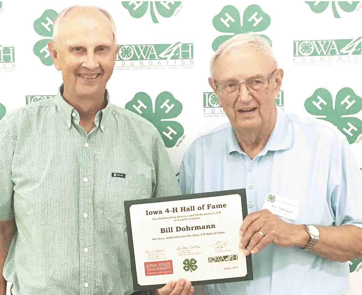 Bill Dohrmann (right) was inducted into the 4H Hall of Fame at the Iowa State Fair, Sunday, Aug. 18. He is shown here after receiving the honor, with his brother, Boyd Dohrmann, who had previously been inducted. Former Fayette Mayor Inducted into 4-H Hall of Fame...