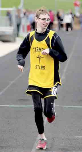 Drew DeLuca keeps the pace as he runs with his fellow Starmont Stars track members.  Diagnosed on the autism spectrum at 2 years old, Drew stays busy through a variety of extracurricular activities.  (submitted photo)  	DeLuca runs the gambit of extracurriculars...