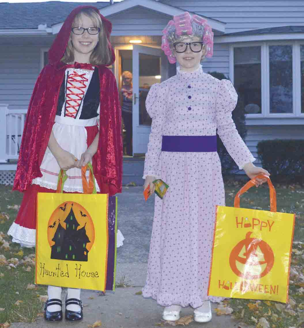Trick-or-treating will be held Thursday, Oct. 31, in Ossian this year. Last year, young trick-or-treaters Jenna and Avery Peters (l-r) enjoyed the evening of gathering candy and treats throughout the streets of Ossian. (Zakary Kriener photo)Local trick-or-treating timesLocal...