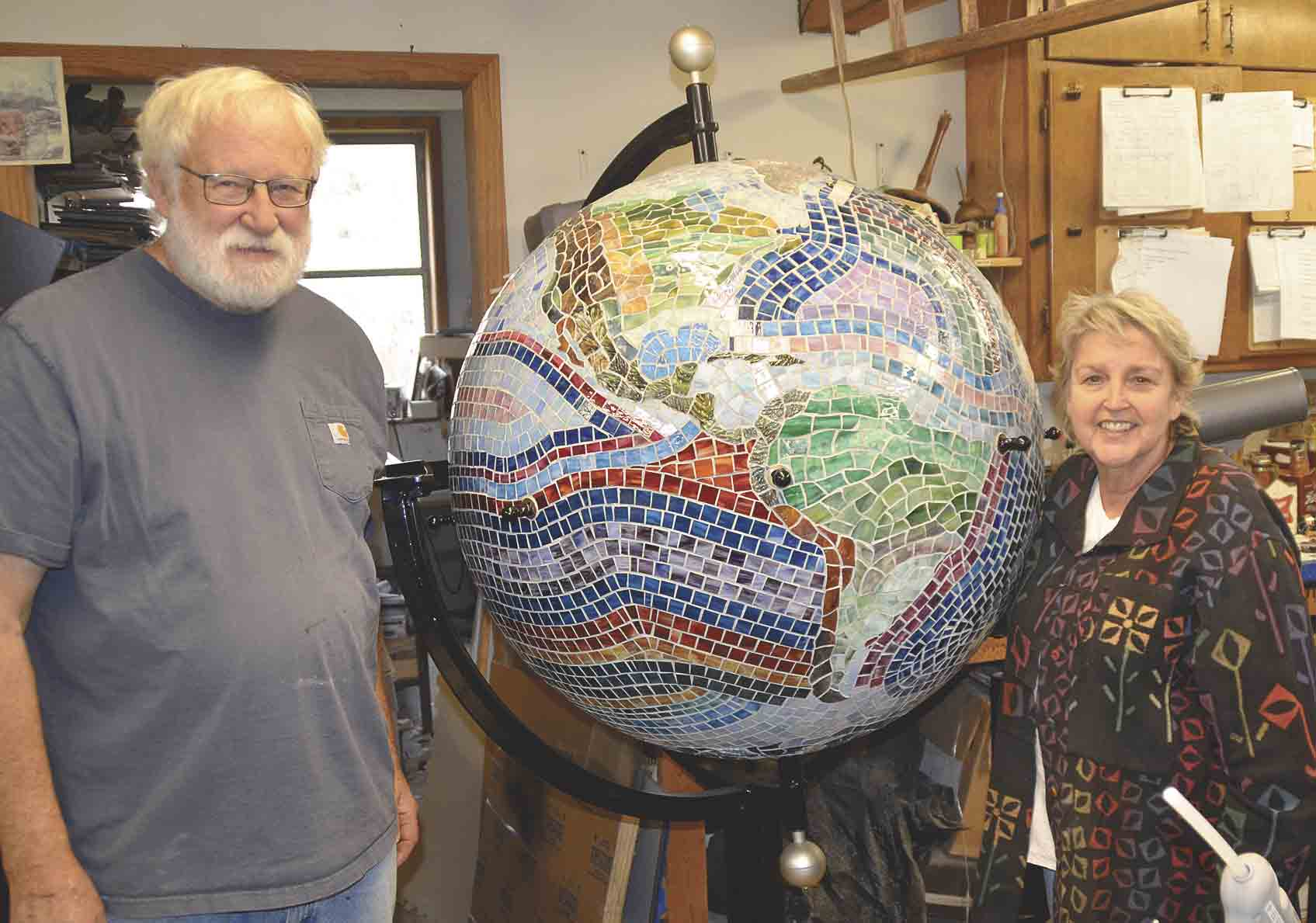 """Steve and Peggy Kittelson have spent untold hours crafting the """"Hometown To The World"""" art piece for the City of Postville. (Jack Swanson photo)Local artisans create window to the worldBy Jack Swansonjswanson@fayettecountynewspapers.comHow..."""