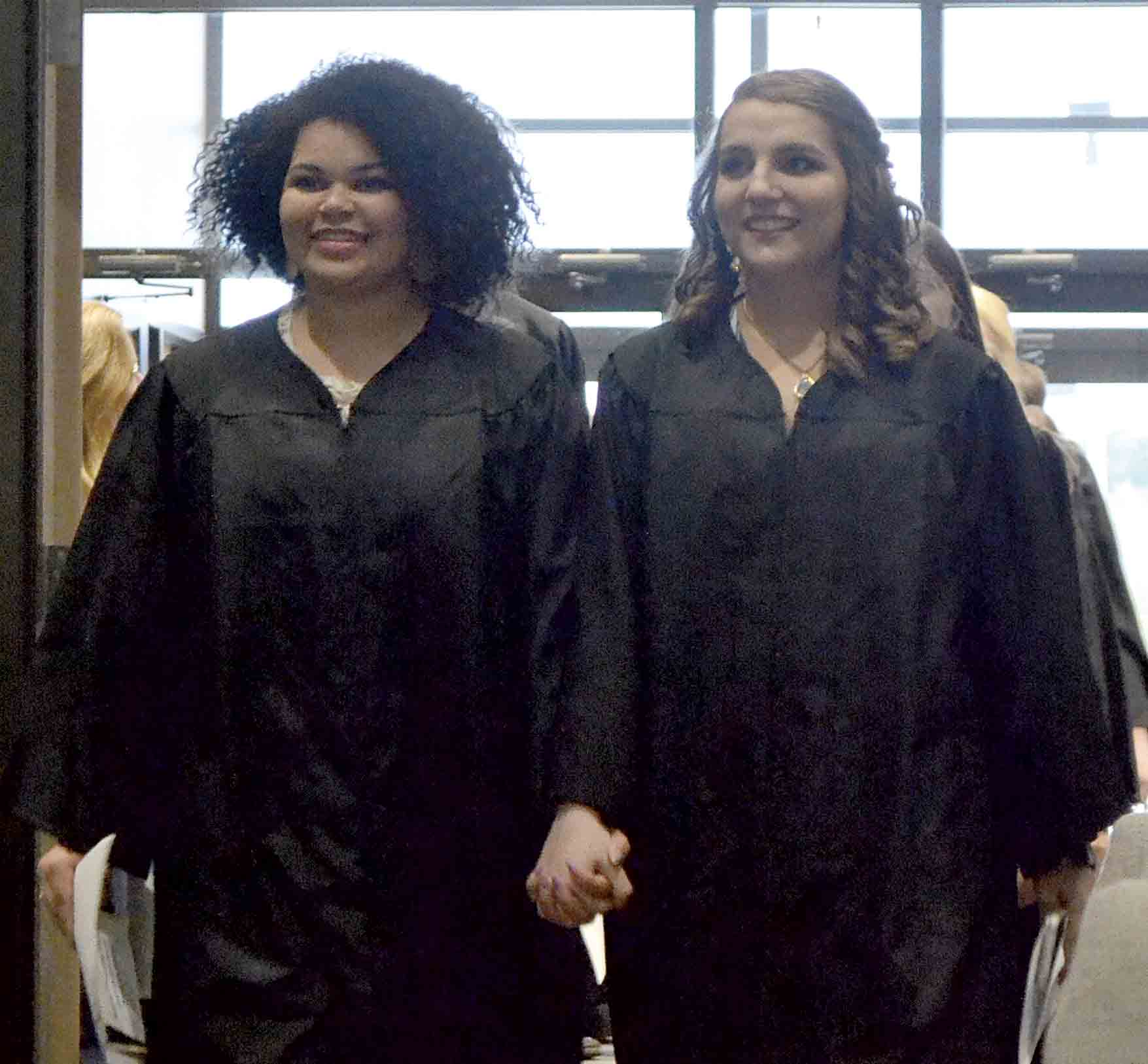 North Fayette Valley seniors Ava Hutchinson and Katelyn Tyler (l-r) walk hand-in-hand into Sunday evening's baccalaureate at the First Baptist church in Elgin. (Megan Molseed photo)NFV Graduation 2019By Meagan Molseedmmolseed@...