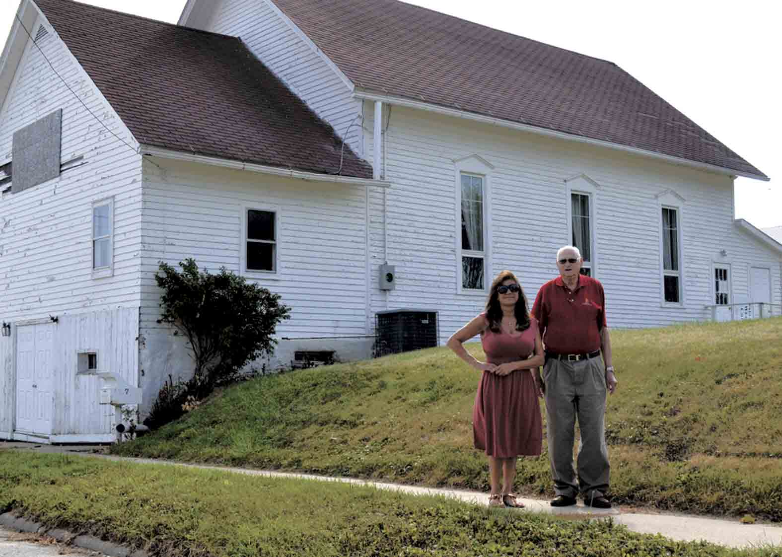 David Goldsmith (right), the son of a former pastor at the Wesleyan Church in West Union, spearheaded the efforts to move the now-empty church to Heritage Farm Park near Clermont nearly a year ago. Goldsmith, who now resides in Loveland, Colo., recently made a visit to his childhood...