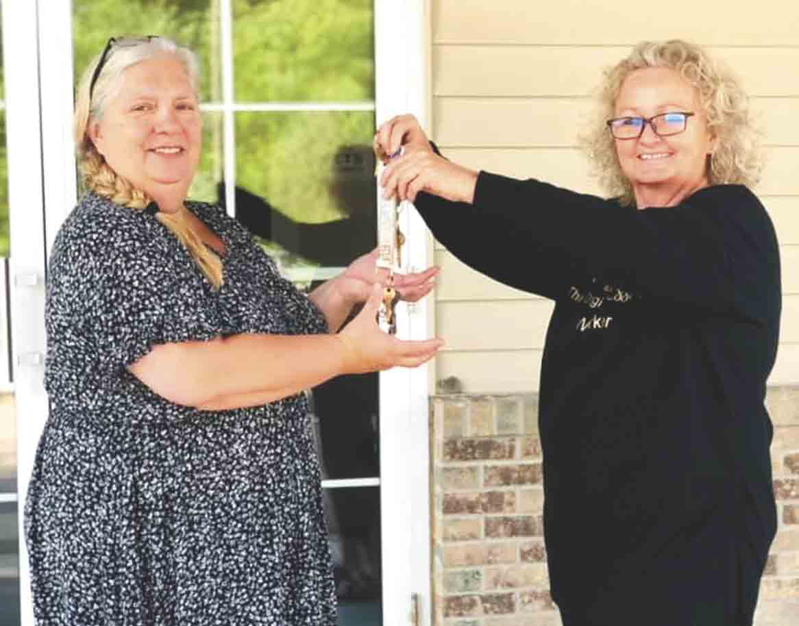 Nancy Wulfekuhle (right) is shown handing the keys of Boarders Inn in Fayette off to new general manager Mina Grasso. The Wulfekuhles recently sold the hotel to Mitra Patel and family out of Wisconsin. The Wulfekuhles started the hotel business 20 years ago. (Photo submitted)...