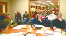 There was a crowd on hand to hear the Hawkeye City Council discuss the fate of the city ice skating rink, Monday night. At lower left is councilman Don Kelly, and at center, council persons Mark Creery and John Campbell. Resident Keith Kovarik, who was the impetus behind creating the rink on top of the fenced-in tennis courts in Hauth Park, five years ago, resigned as coordinator and park board member after city wastewater and streets director Dana Franzen (pictured at left center) locked him out of the bui